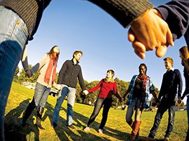 young-people-hold-hands-circle-istock